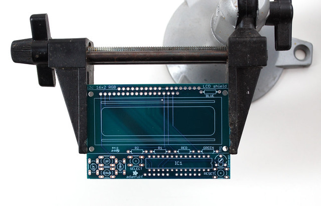 Put The Printed Circuit Board Into A Vise Or Board Holder Heat Up