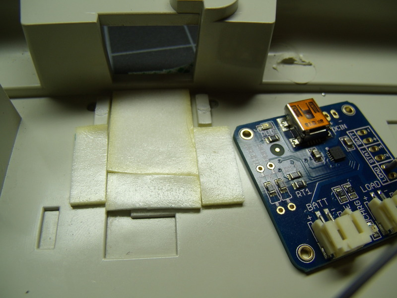 hacks_024_foam_tape_under_charger.jpg