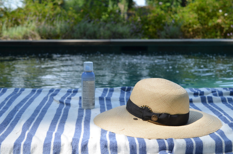 light_sunscreen-reminder-hat-on-towel.jpg