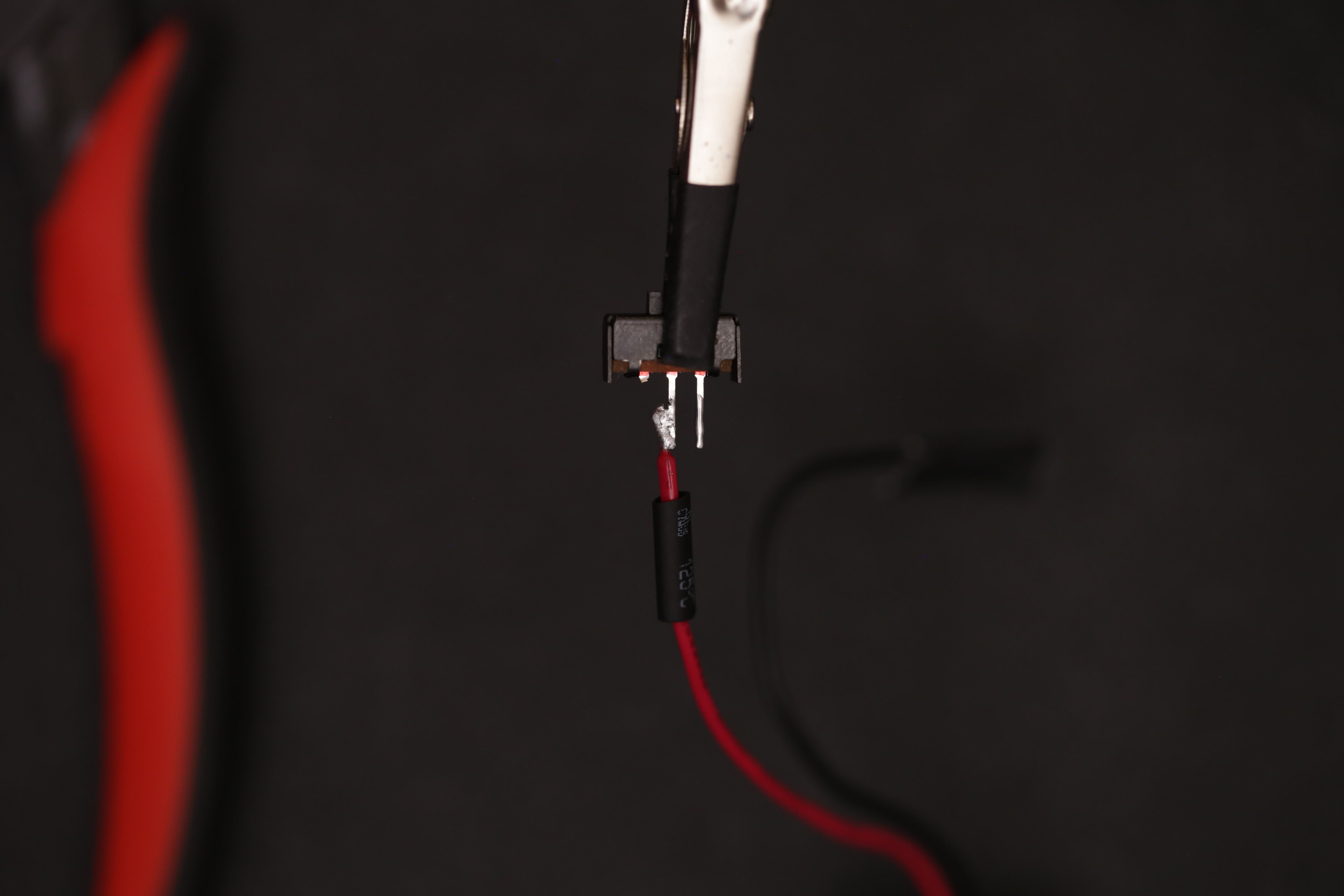leds_solder_red_bat_wire_to_switch.jpg