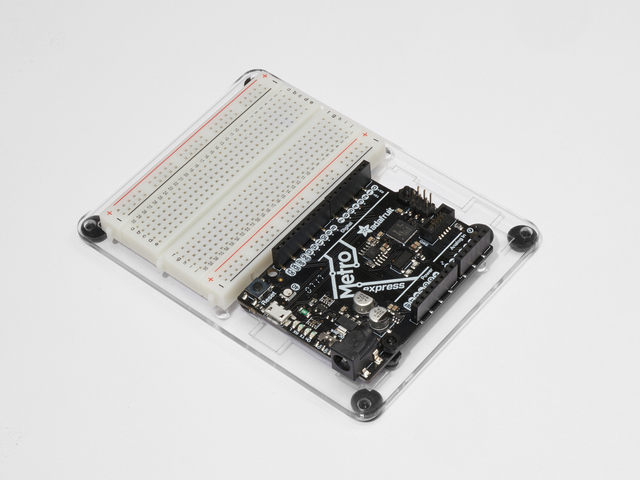adafruit_products_Metro_Breadboard_Routing_Plate_RedoWhite_Background.jpg
