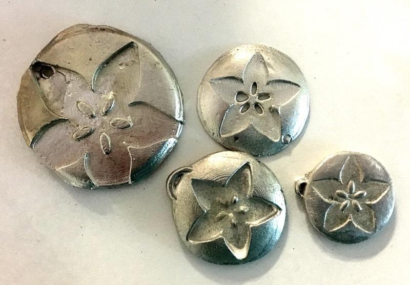 3d_printing_adafruit_pewter_pendants.jpg