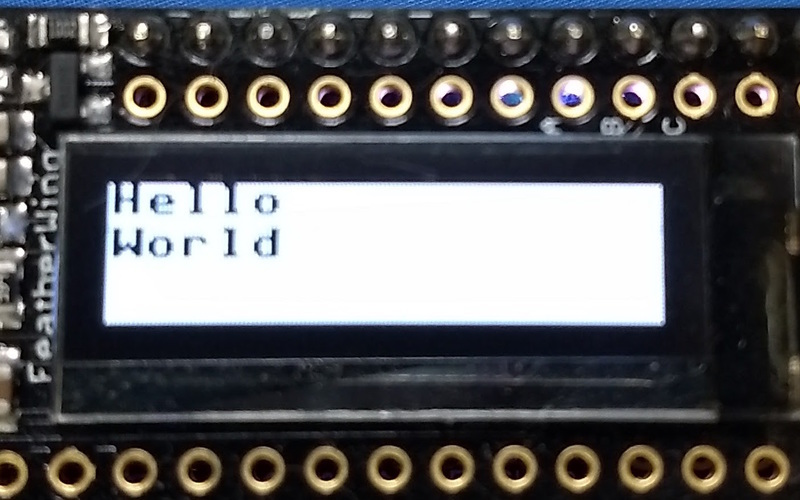 adafruit_products_oled_featherwing_hello_world_inverted.jpg