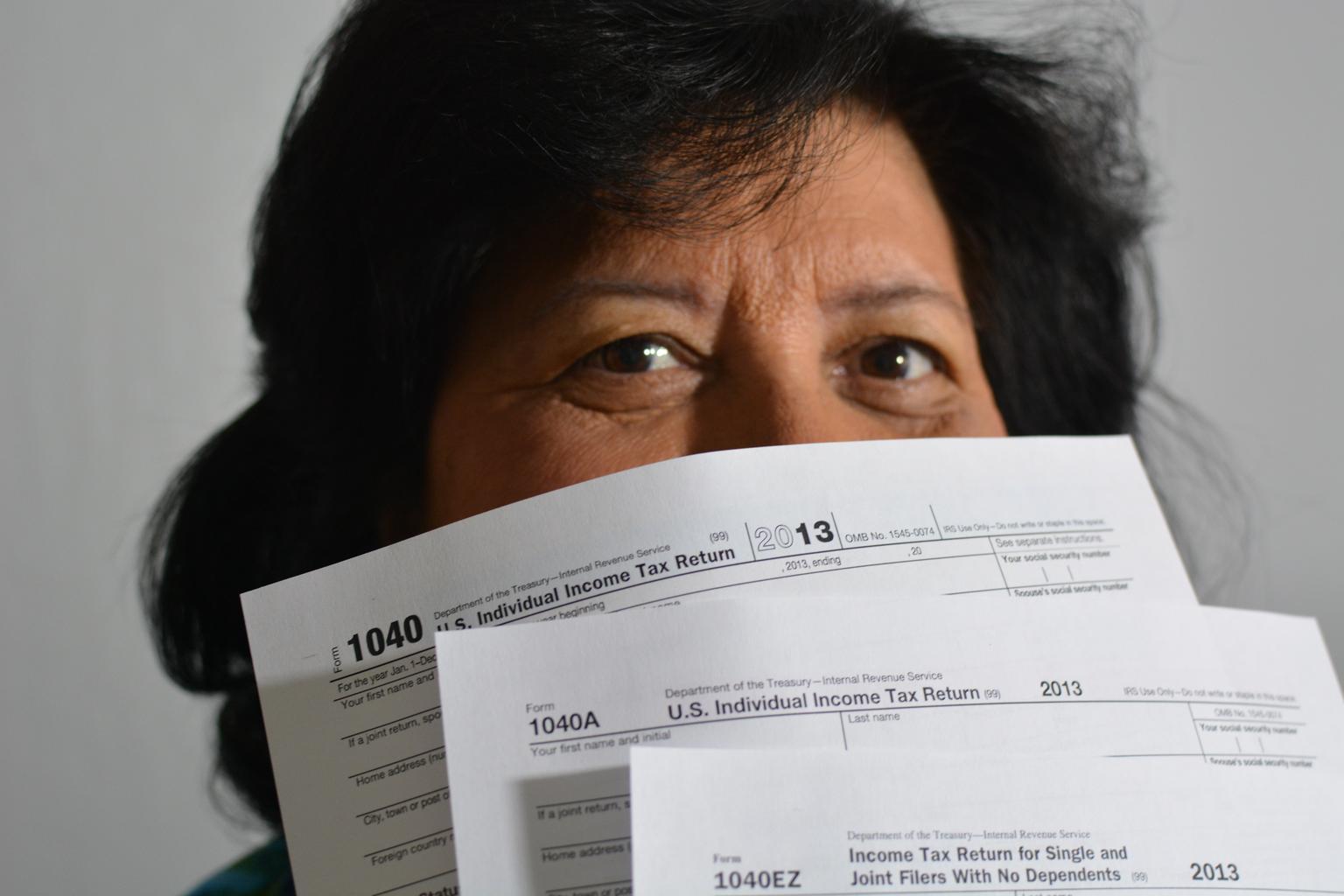 community_support_taxes_bills_1040_woman.jpg