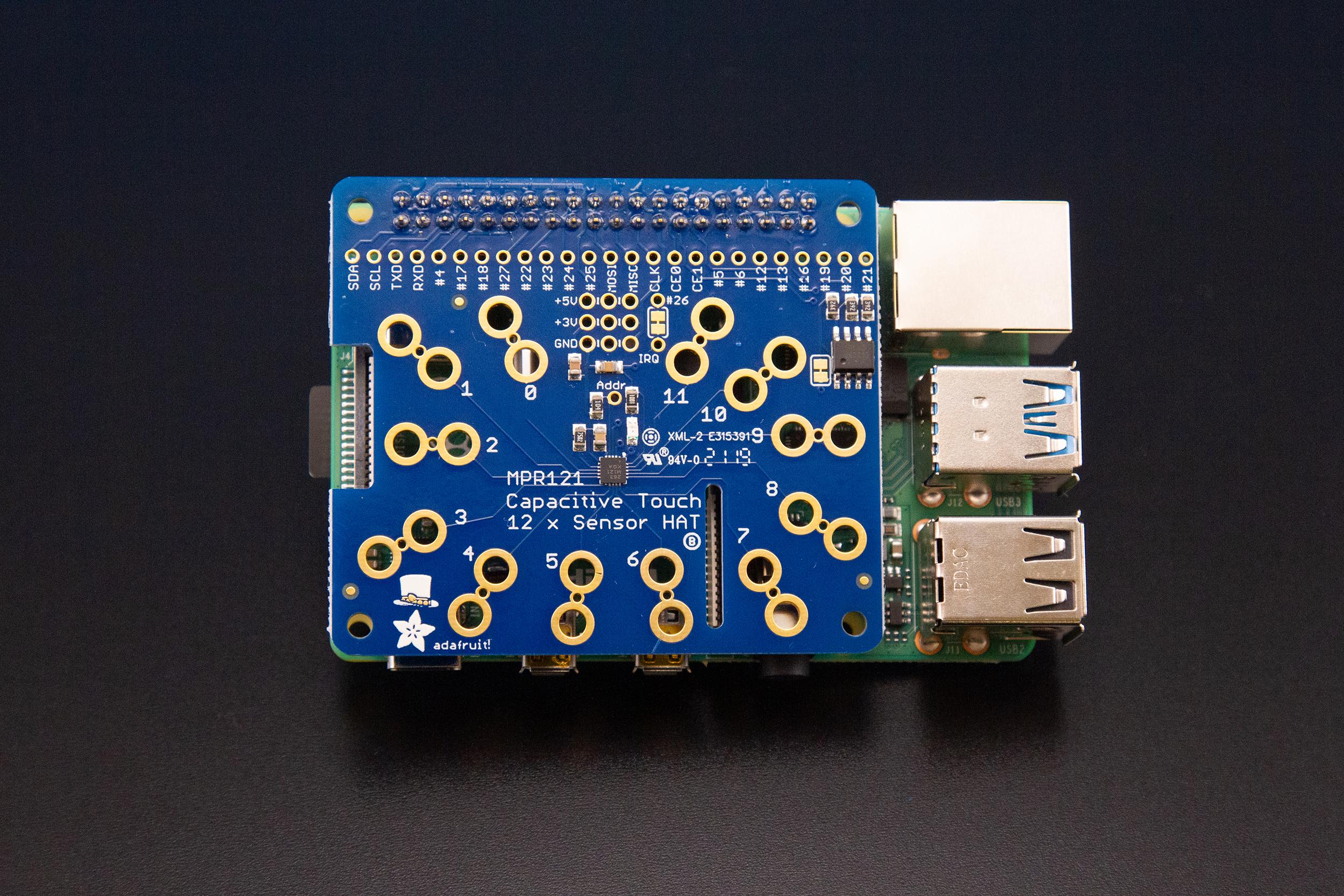 sensors_MPR121_HAT_on_Pi.jpg