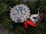 leds_CPB_NeoPIxel_Controller_gator_clips_close_up_on_wreath.jpg