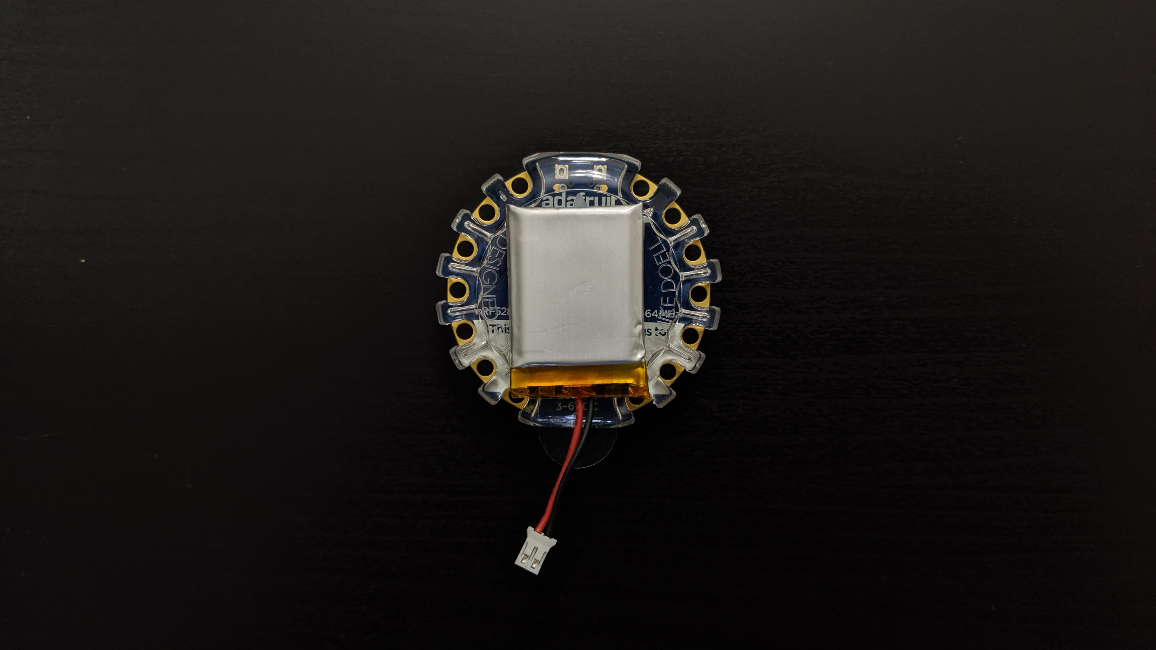 leds_CPB_NeoPIxel_Controller_battery_taped_to_enclosure.jpg