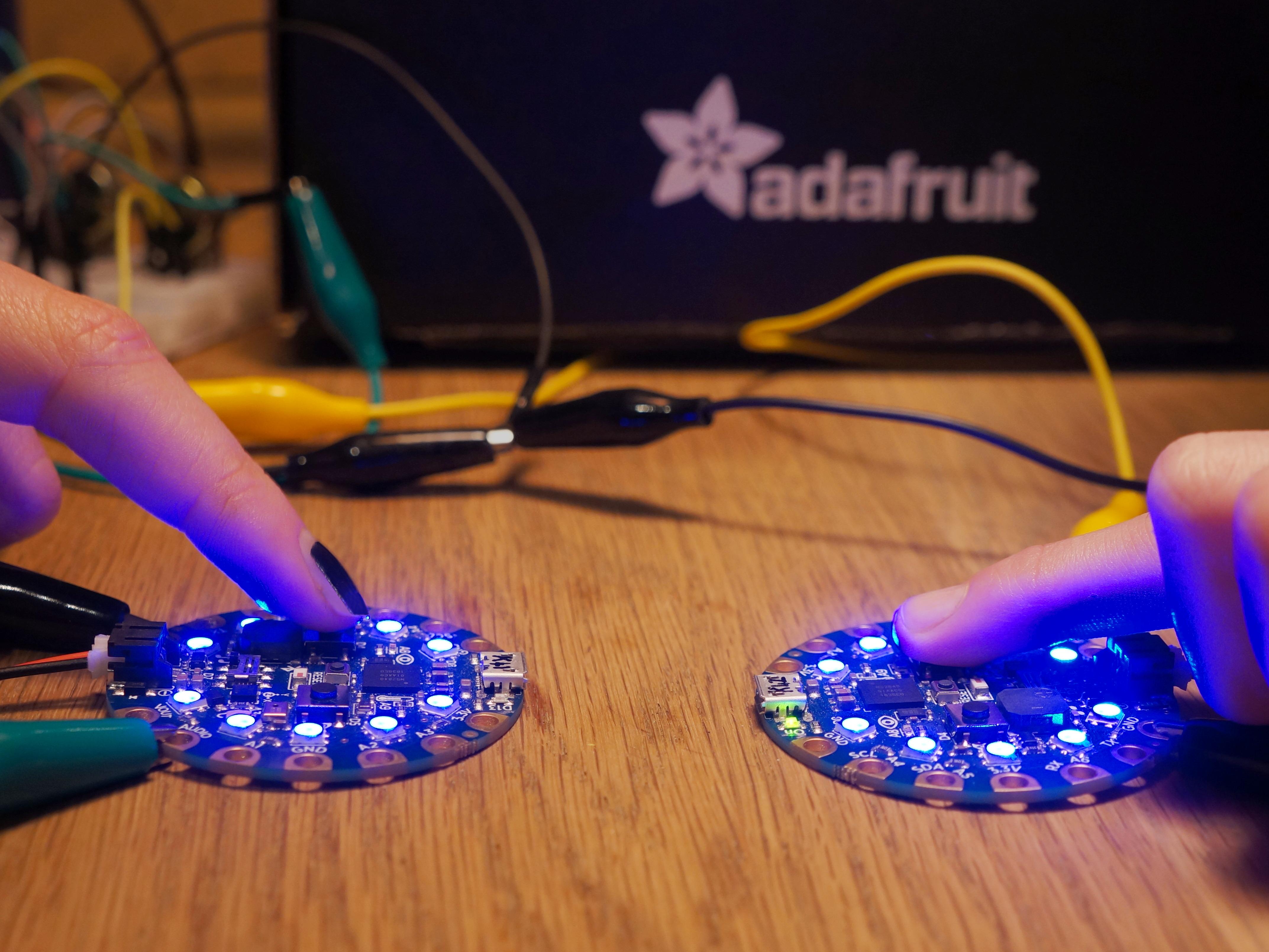 circuitpython_cpb-quick-draw-blueflash-woodentable-2000x1500-ii.jpg